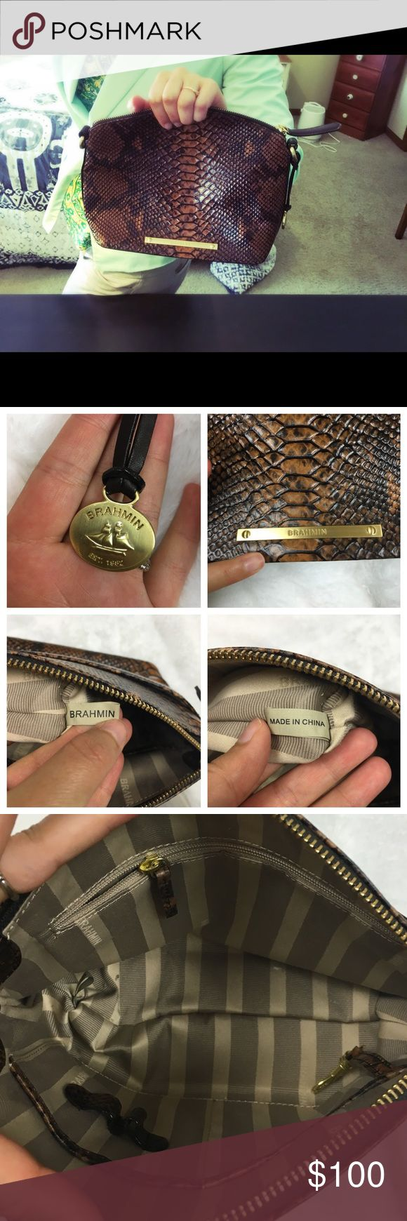 EUC Authentic Brahmin Classic Brown Clutch / Bag Literally looks almost brand new and so classic and chic. Brahmin brand. There is very light wear on inside and bottom but barely noticeable. Plastic covering still on outside charm. Has hooks for straps but no strap is included. Perfect for back to school. 10aug16bbko Brahmin Bags