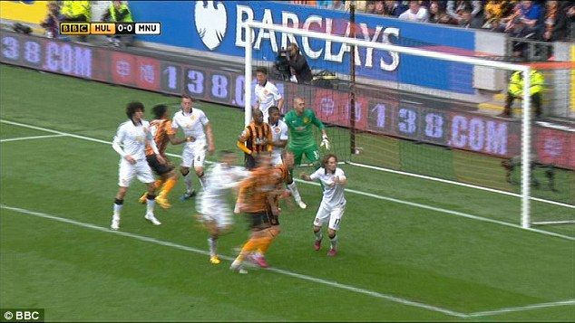 The fist of Abel Hernandez (second left) can clearly be seen making contact with Phil Jone...