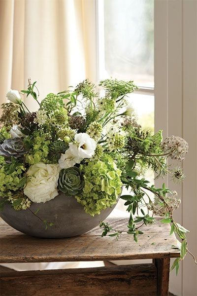 When styling a floral arrangement, cushion flowers amongst stems cut at different lengths to create a layered look with subtle pops of colour.