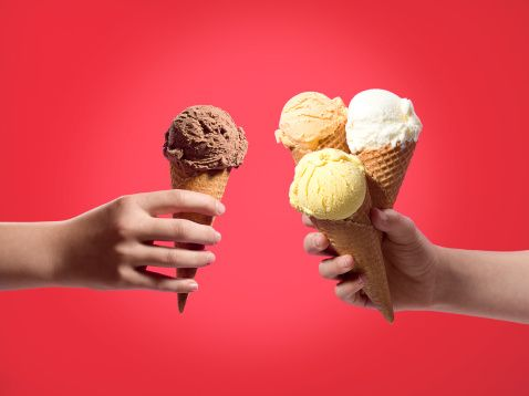 Stock Photo : One ice cream in one hand, three in the other