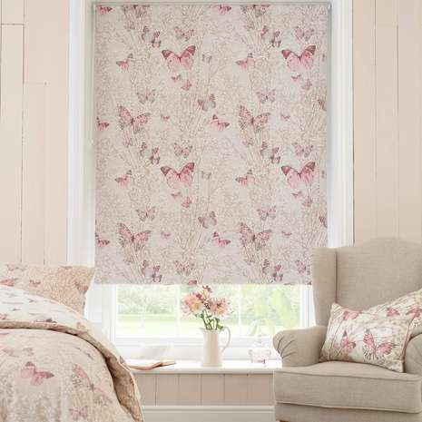 Decorated with a floral and butterfly pattern in pink on a natural backing, this roller blind is equipped with a full blackout lining to exclude all unwanted light and is also available in a range of widths.
