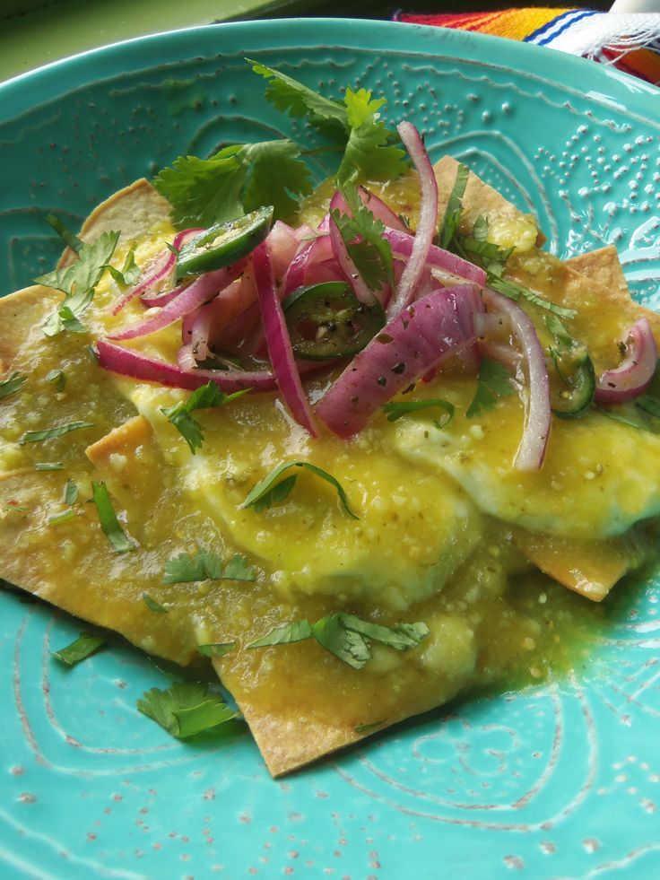 Chilaquiles Verdes con Queso Panela y Cebollas en Escabeche ( Baked Tortilla Chips in a Warm Salsa Verde and Mexican Cheese) #foodsforlent