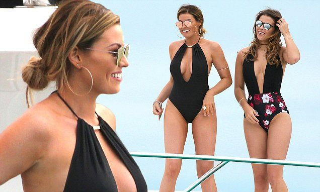 Jessica Wright and Chloe Lewis battle it out in plunging swimwear