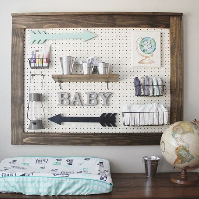 Love, love the idea of a pegboard over the changing table for extra storage.  Design by: @heatherbahorich