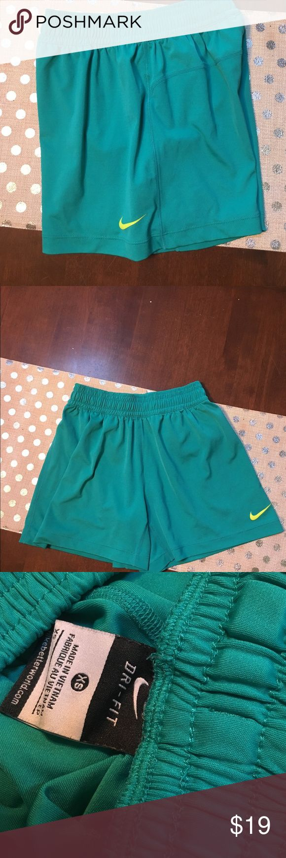 Nike Dri Fit Shorts XS Nike Size XS Dri Fit Running Short. Excellent condition. Sea-foam Green with Neon Yellow Swoosh. Nike Shorts