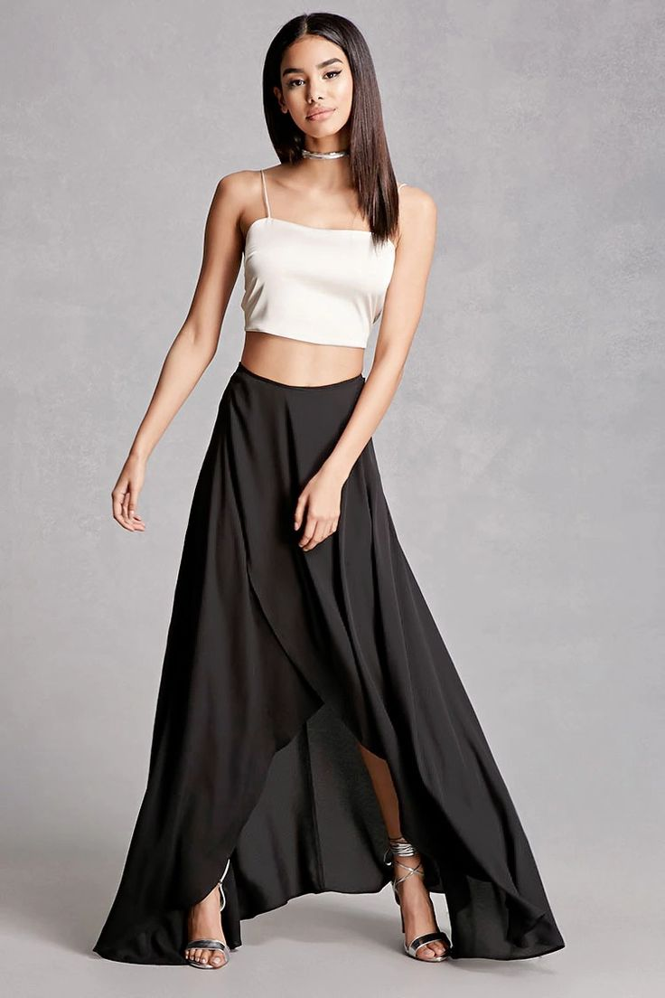 A textured woven maxi wrap skirt by Selfie Leslie™ featuring a high waist, wrap design with a self-tie, a draped curved hem, concealed back zipper, and mini skirt underlay.