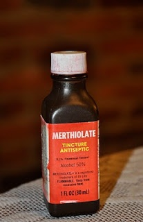 Merthiolate - It was tiny, made of brown plastic and had a white lid; I cried every time I saw it coming my way.