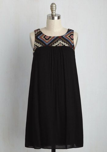 This evening's lakeside festivities find you in this cute black shift dress, enjoying the beautiful scenery and company of good friends. As you take a twirl around the lawn, the vibrant woven neckline and feather-light fabric of this fun frock whirl with you as an effortless expression of your easygoing style.