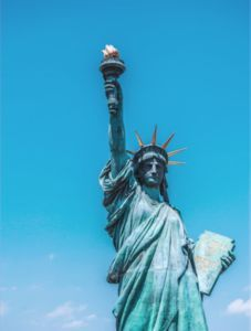 """Emma Lazarus (1849-1887) was a Jewish American poet, best known for her sonnet """"The New Colossus."""" This poem is currently engraved on a bronze plaque and displayed on the Statue of Liberty's pedestal. The statue stands across from the historic Ellis Island, through which millions of immigrants came into the U.S. in the late 1800s and early 1900s."""