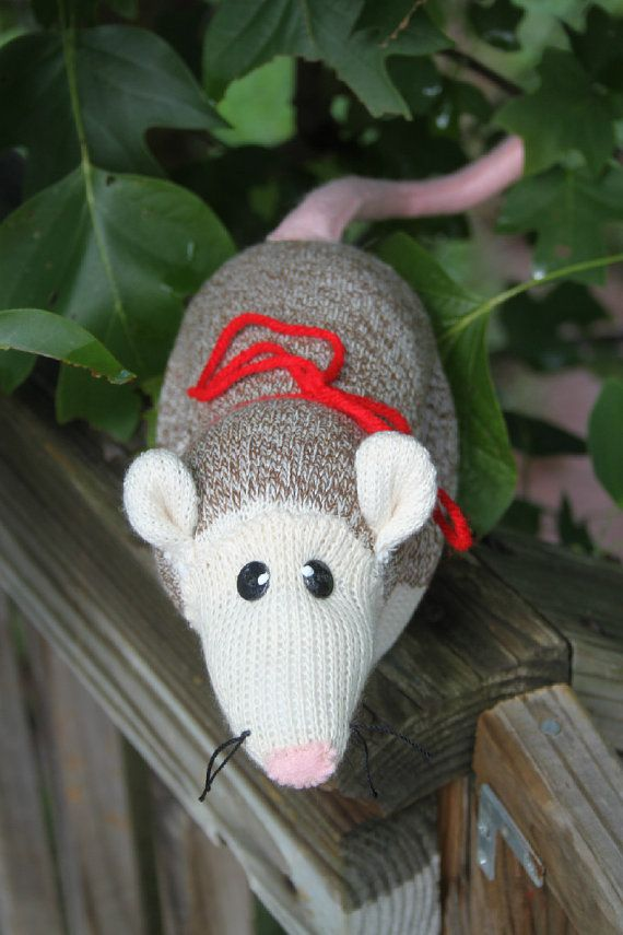 Handcrafted Sock Monkey Opossum! This little fella is created out of Fox River Mills Red Heeled socks. Measures about 12 long, not including his