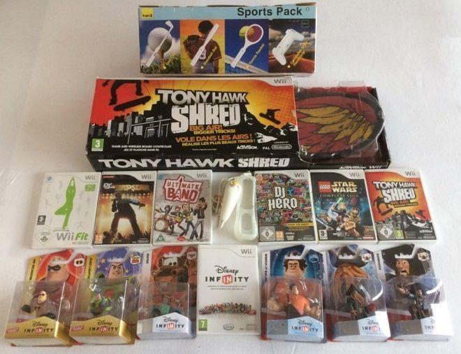 Online veilinghuis Catawiki: 7 Nintendo Wii games & accessories (Skateboard, Sports pack, Cover, Nunchuck) + 6 Disney Infinity figures