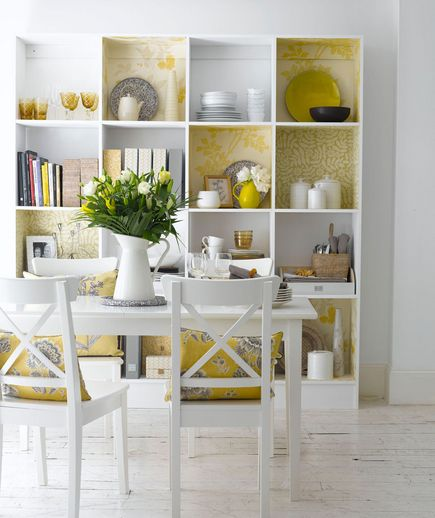 Line the backs of boring shelves with wall paper or shelf paper to give it a quick, new look!