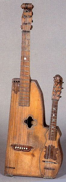 """... again more rustic than the photo leads one to believe – despite the fancy carved heads – was the interesting 1894 Verona """"guitar-mandolin,"""" which I've ..."""
