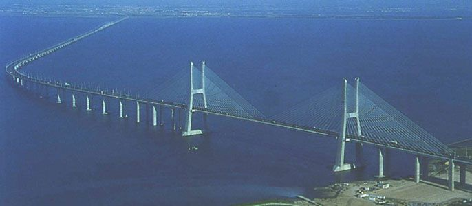 In 1998, after 3 years of construction, the 17.2km long Vasco da Gama Bridge near Lisbon (Portugal) was opened. The cable stayed bridge, with approach viaducts on both sides, spans the Tejo river. It is Portugal's largest construction of all time and after the Øresund Bridge between Denmark and Sweden, it is the longest bridge in Europe. To maintain unhindered navigation of ships in the  Tejo river, the main section of the crossing was constructed as a cable stayed bridge.