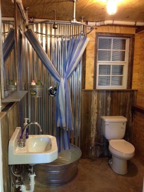 A functional barn bathroom The shower basin is a galvanized steel tub converted with a shower