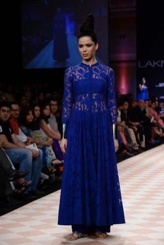 Anita Blue Netted Anarkali Gown by Anita Dongre   Find more inspiring occasion wear and Indian wedding fashion at #myjivaana.  Discover. Share. Shop.