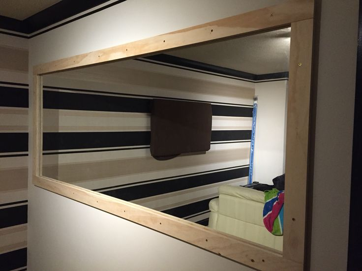 Mirror fitted with 12mm white planed wood with 18mm ply board frame with small recess all the way round for Philips hue led strip