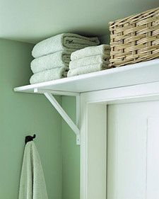 Build a shelve above the bathroom door to gain more space.. this is great for small bathrooms!