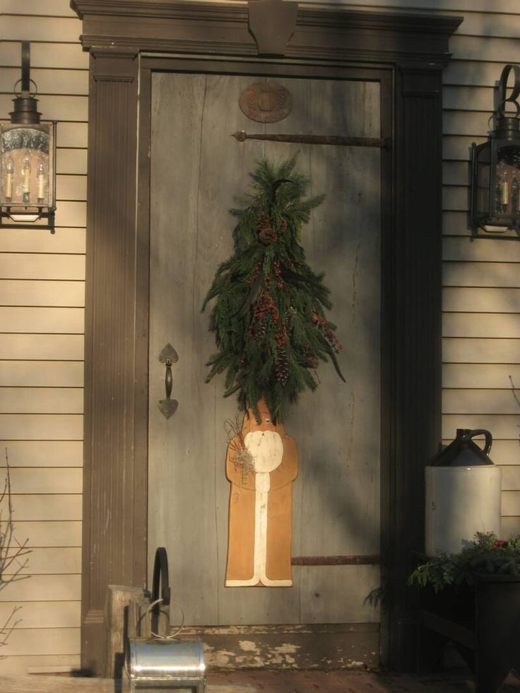 Outdoor Christmas Decorating- Love Santa dummy boards on front doors! BTP