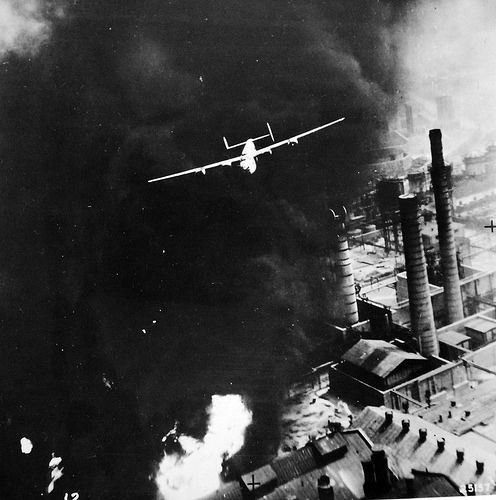 """Allied Air Raids in Europe, WWII. Astra Romana Refinery. This photograph gives a vivid idea of how the Consolidated B-24 """"Liberator"""" flew in bombing the Ploesti Field, August 1, 1943. Office of War Information Collection. Courtesy of the Library of Congress"""