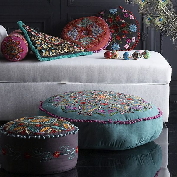 Suzani embroidered pouffes and pillows. ottomans. textiles. ethnic textile. embroidery. pillows