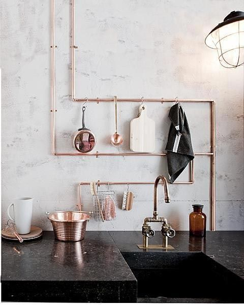 Clever idea for DIY utensil rack. Maybe do something similar with galvanized pipe, perhaps painted a bold color.