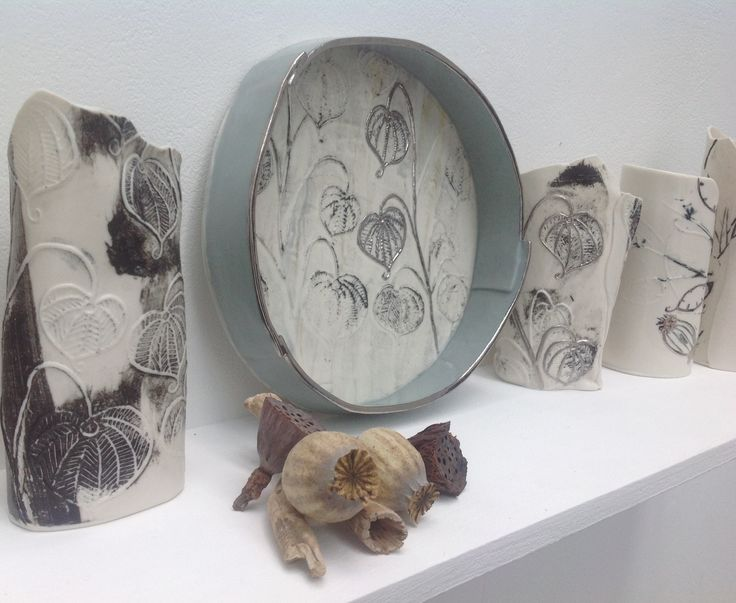 Chinese lantern plant collection. Each piece  is unique, handmade, in porcelain paperclay with recycled paper fibres, printed with plaster slabs, and black slip , Slab rolled and finish with platinum lustre.