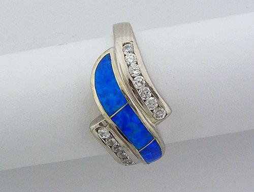 925 Sterling Silver Ring with Blue Opal and clear Cubic Zirconia. This beautiful ring weights 5 gram, and it is size 7.