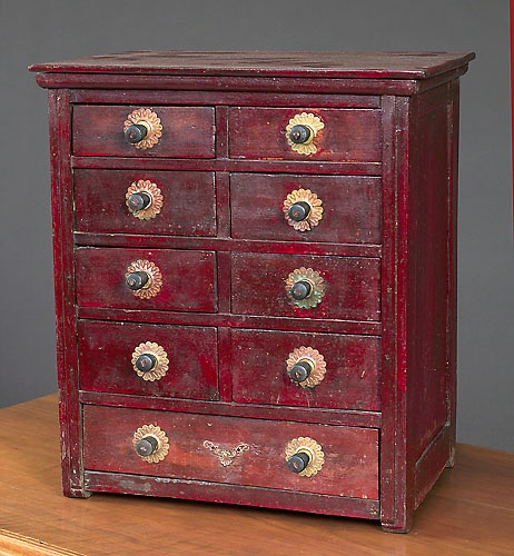 Pine and poplar, nine nailed drawers. Published in Burgess, Century Wooden Boxes, p.
