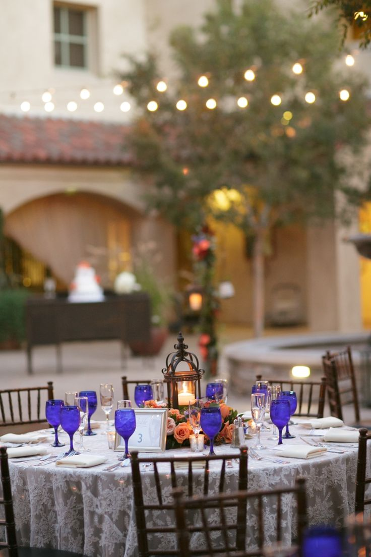 Lantern centerpiece // photo by BrittRene Photo, see more: http://theeverylastdetail.com/cobalt-blue-spanish-inspired-wedding/