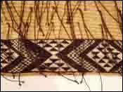 AB - The history of New Zealand flax: Taaniko border on bottom of a Korowai cloak