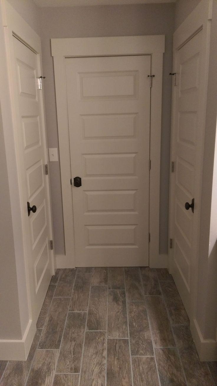 """Installed """"old school"""" door knobs to go with the five panel doors."""