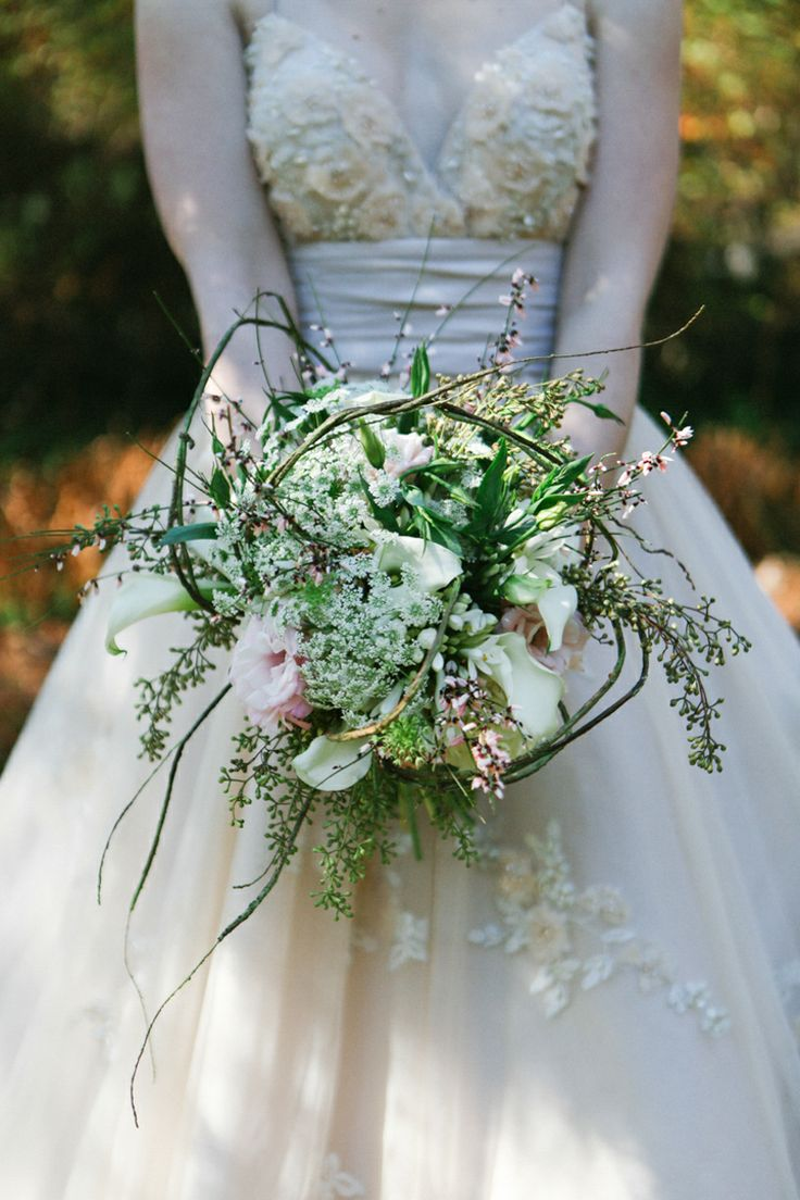 Wild wedding bouquet for this woodland romance style shoot! by Leah Moyers Photography. Click to see the full post.  http://www.thebridelink.com/blog/2014/05/15/knoxville-wedding-style-shoot-at-rt-lodge/