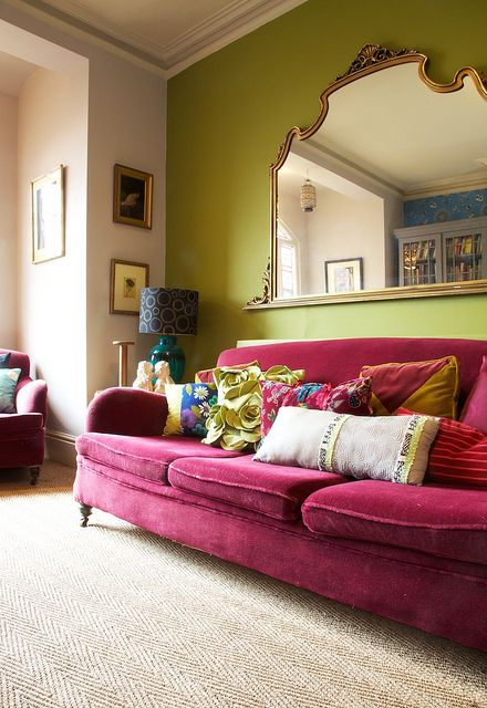 fuschia velvet sofa and chair with green wall
