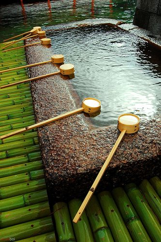 A chōzuya or temizuya (手水舎) is a Shinto water ablution pavilion for a ceremonial purification rite known as temizu. Water-filled basins, called chōzubachi, are used by worshipers for washing their left hands, right hands, mouth and finally the handle of the water ladle to purify themselves before approaching the main Shinto shrine or shaden (社殿).