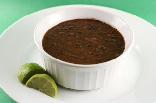 Tangy Black Bean Slow Cooker Recipe-This soup feels like a vacation in a bowl. The bit of heat from the chipotle chile powder is washed away by the fresh citrusy tang. My whole family loved this soup, as did our neighbors! I kept my soup pretty light, but Adam and the kids added cheese, sour cream, and avocado slices to their bowls (and Tostitos scoop chips....