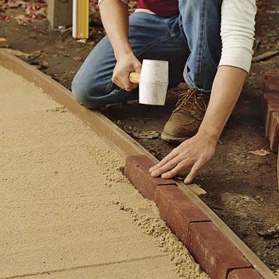 Lay the brick edging | How to Lay a Brick Path | This Old House