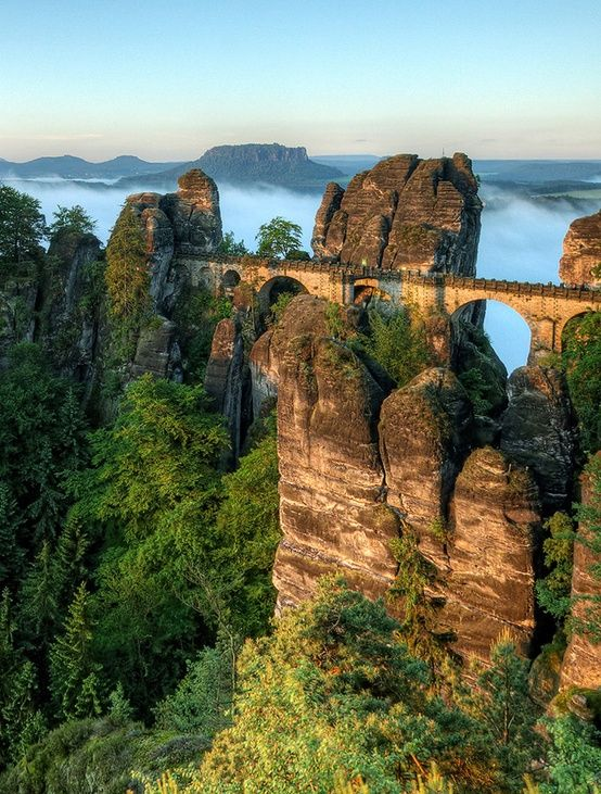 The Bastei Bridge (also known as Basteibrucke) is located in the Saxon Switzerland National Park in the Elbe Sandstone Mountains and is part of a trail extending through Germany, Switzerland, and into the Czech Republic. The bridge sits 200 meters (approximately 650 feet) above the Elbe River in Germany.