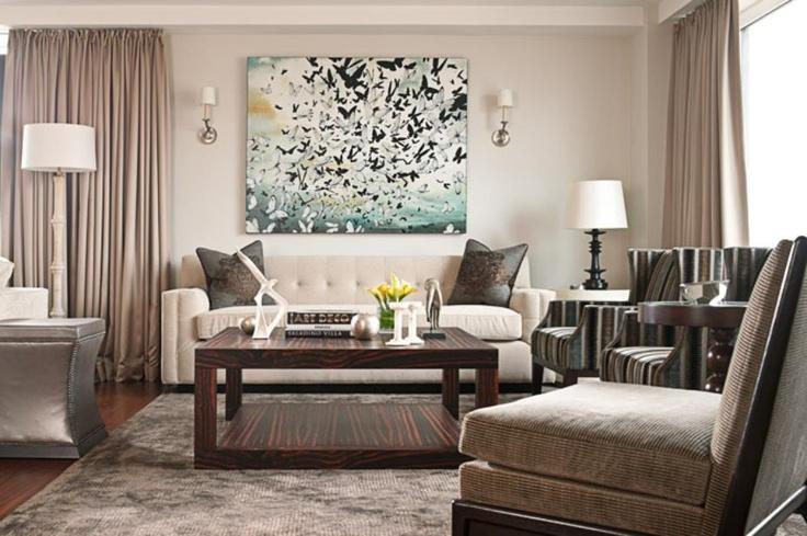 Elegant and contemporary living room with unique butterfly art. #interiors #design #interiordesign #decor