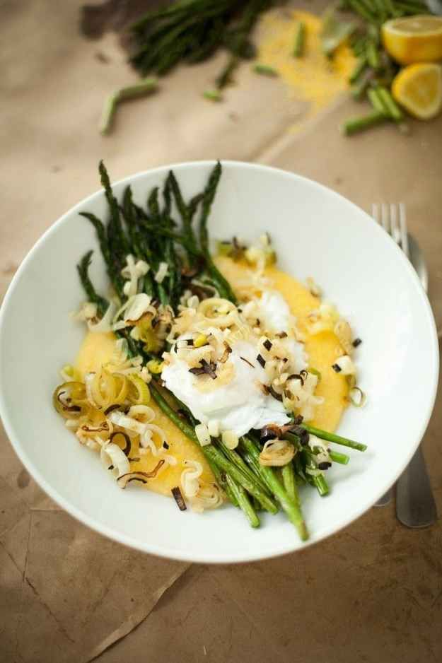 Broiled Asparagus, a Poached Egg, and Charred Spring Onion & Garlic over Polenta | 33 Cuddly And Delicious Beds Of Polenta