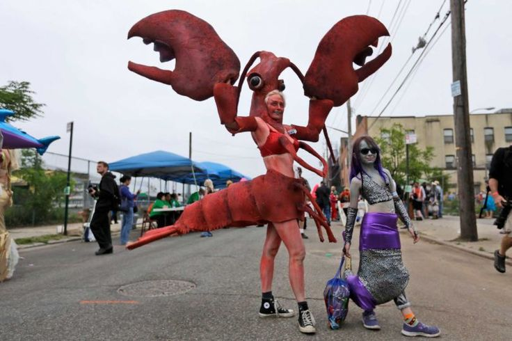 Katherine Gates, left, as a Lobster, and her daughter Lucy Warner, 8, as a mermaid, pose in Coney Island's Mermaid Parade