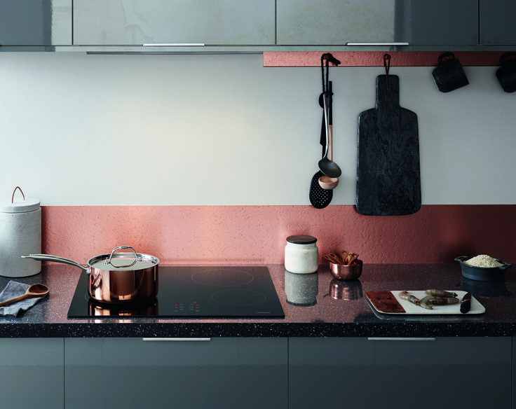 Consider using off-cuts from your wall panels to create a bespoke matching hanging rack for crockery and utensils. Accessories such as copper pots and pans and a slate chopping board bring warmth and texture to your kitchen whilst keeping everyday items close to hand. Greenwich Gloss Slate Grey from The Universal Collection by Howdens Joinery.