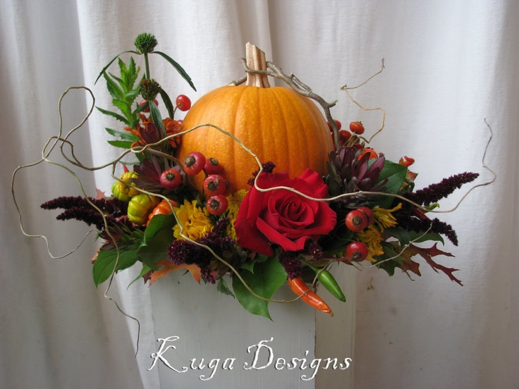 That's how to arrange a pumpkin! floral. Put this on top of a stemmed planter by the front door!!
