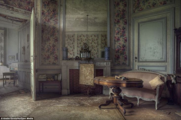 A child's toy is left on a table. With everything from worn slippers to books and old clothes, this old mansion has apparently lay abandoned since the early 1990s. Round Mansion in Belgium was discovered and photographed by urban explorer Andre Govia. The nine bedroom mansion was abandoned sometime in the early 1990s.