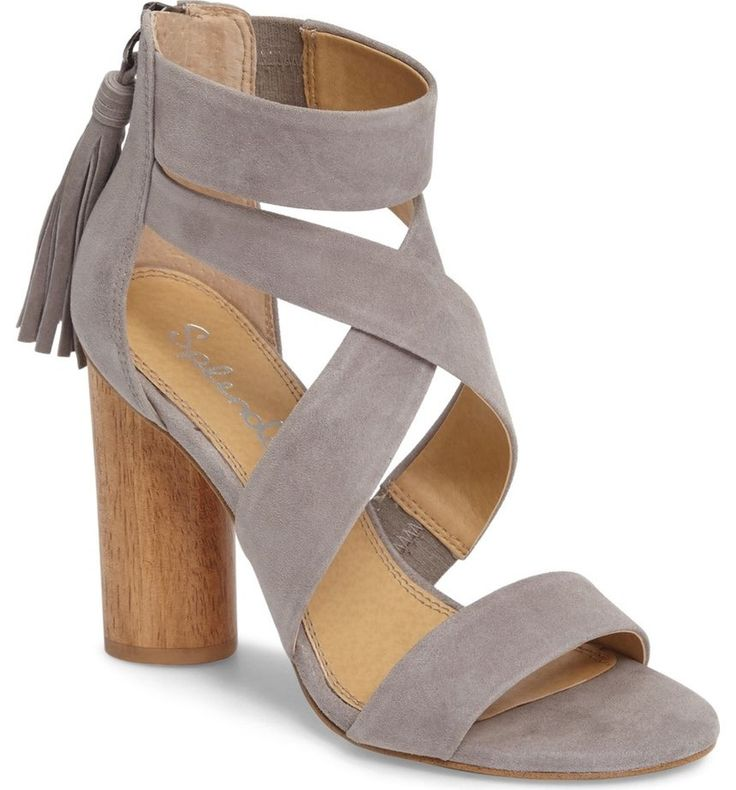 A back tassel dances above the statement woodgrain heel of this strappy sandal in trend-right suede.