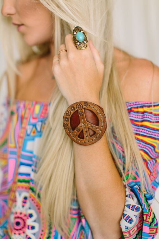 Our beautiful genuine leather cuffs are handmade with love and made in mind for the bohemian love child in every girl. Featuring a peace sign with engraved floral design or studs.