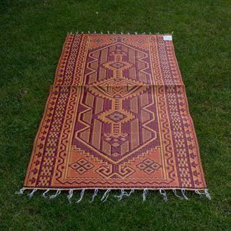 Plastic tapijt in rood oranje patroon