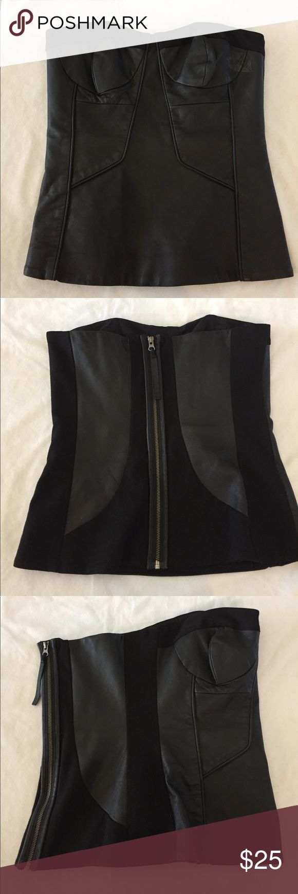 "L.A.M.B. corset bustier size 10 flaw LAMB leather corset Gwen Staffani collection size 10 measures flat-bust 16"", waist 15.5"", bottom hemline 19"" has fantastic support with stretch fabric on sides and in back. This piece has a flaw on the left bust under the arm. The leather was damaged by tape and needs recoloring in that area. The leather itself is not ripped or torn. Please note price is reduced to reflect flaw shown in photo. L.A.M.B. Tops"