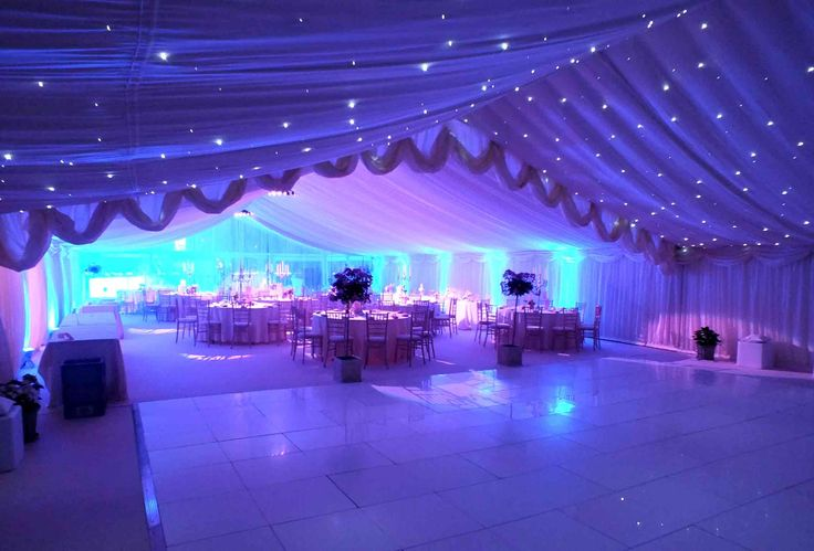 wedding-marquee-with-ivory-starlight-white-dancefloor-and-purple-lights.jpg 2,268×1,538 pixels