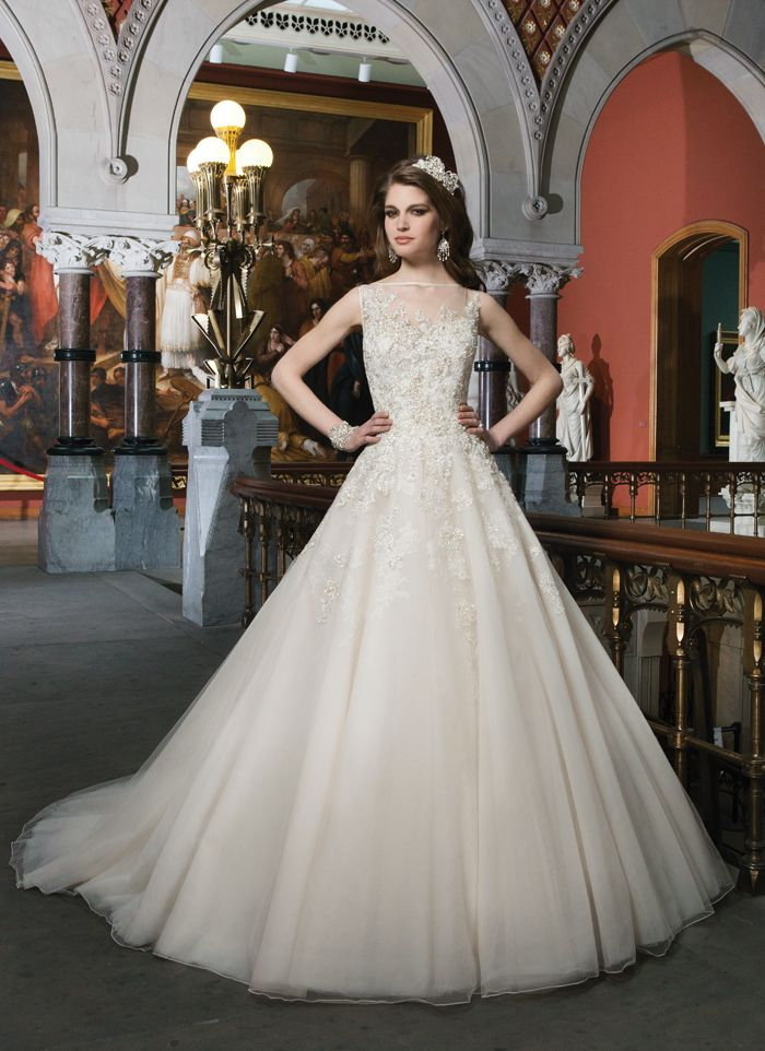 Justin Alexander wedding dresses style 8726 Beaded embroidered and corded lace tulle ball gown features a Sabrina  illusion neckline. Style has a high beaded illusion back with regal  satin buttons and a chapel length train.